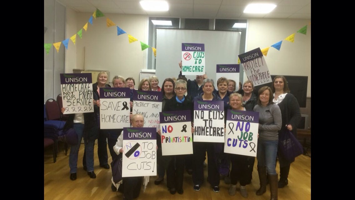 Home support workers demonstrate against council cuts in their service – gathering public support by asking members of the public to sign the Unison petition letter.
